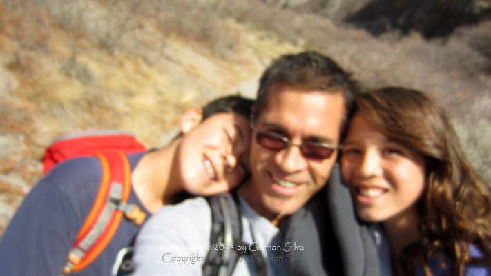 Diego, Natalia and I coming back from hiking the Grove Creek Trails , above Pleasant Grove, Utah.  This picture captured a very  tender moment -- or they were very tired!!  :)