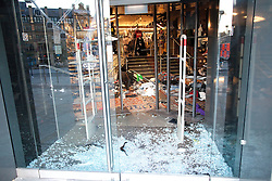 © Licensed to London News Pictures. 09/08/2011. Manchester, UK. Destruction and looting  across the city centre by gangs. Shops are smashed, looted. Footasylum is looted. Photo credit : Joel Goodman/LNP