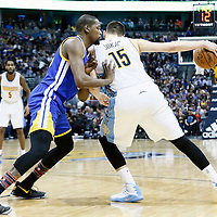13 February 2017: Denver Nuggets forward Nikola Jokic (15) posts up Golden State Warriors forward Kevin Durant (35) during the Denver Nuggets 132-110 victory over the Golden State Warriors, at the Pepsi Center, Denver, Colorado, USA.