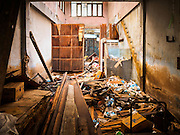 02 SEPTEMBER 2015 - BANGKOK, THAILAND: An abandoned shophouse in the Bang Chak Market. The Bang Chak Market serves the community around Sois 91-97 on Sukhumvit Road in the Bangkok suburbs. About half of the market has been torn down, vendors in the remaining part of the market said they expect to be evicted by the end of the year. The old market, and many of the small working class shophouses and apartments near the market are being being torn down. People who live in the area said condominiums are being built on the land.         PHOTO BY JACK KURTZ