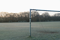 Goal post on empty soccer field