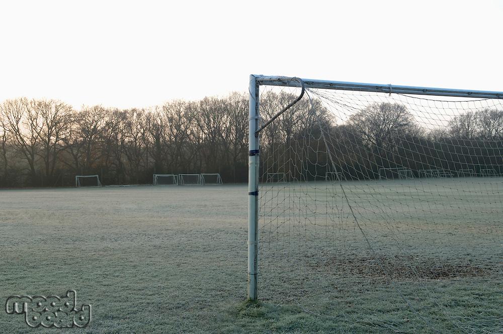 Goal post on empty soccer field