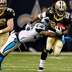 January 1, 2012; New Orleans, LA, USA; New Orleans Saints running back Chris Ivory (29) breaks away from Carolina Panthers safety Charles Godfrey (30) during the fourth quarter of a game at the Mercedes-Benz Superdome. The Saints defeated the Panthers 45-17. Mandatory Credit: Derick E. Hingle-US PRESSWIRE