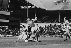 Arsenal's Alan Smith loses his balance after a sliding tackle by Tottenham Hotspur's Gary Mabbutt.