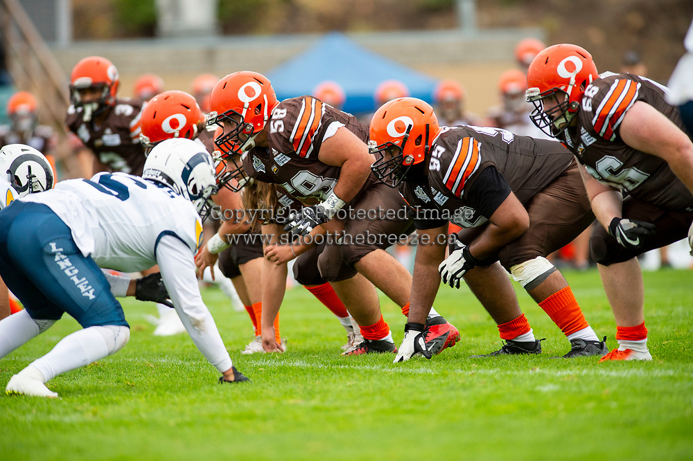 KELOWNA, BC - SEPTEMBER 8:  Danil Balan #58 and Karn Sidhu #95 of Okanagan Sun line up against the Langley Rams at the Apple Bowl on September 8, 2019 in Kelowna, Canada. (Photo by Marissa Baecker/Shoot the Breeze)