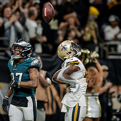 Nov 18, 2018; New Orleans, LA, USA; New Orleans Saints running back Alvin Kamara (41) celebrates a touchdown as Philadelphia Eagles safety Tre Sullivan (37) looks on during the second half at the Mercedes-Benz Superdome. Mandatory Credit: Derick E. Hingle-USA TODAY Sports
