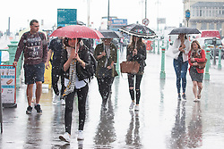 **CAPTION CORRECTION. Incorrect date on original picture. Picture taken TODAY 28/05/2016** © Licensed to London News Pictures. 28/05/2016. Brighton, UK. Members of the public have to shelter from the torrential rain in Brighton as thunder and lightning is hitting the seaside resort. Photo credit: Hugo Michiels/LNP