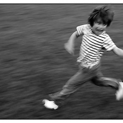 A black and white print of a child running in a park in Paris