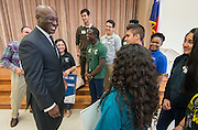 Ken Huewitt talks with students from Sharpstown High School after a Children at Risk awards presentation to area schools at Pilgrim Academy, June 6, 2016.