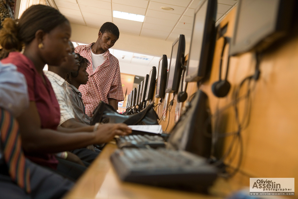 Customers browse the internet at the Busy Internet internet cafe in Accra, Ghana on Thursday February 1, 2007.