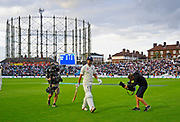 Alastair Cook of England walks back to the pavilion to a standing ovation from the crowd after finishing the day unbeaten in his final test match innings during day 3 of the 5th test match of the International Test Match 2018 match between England and India at the Oval, London, United Kingdom on 9 September 2018.