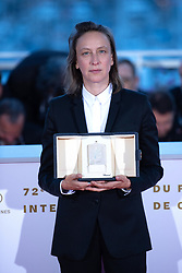 Celine Sciamma, winner of the Best Screenplay award for her film Portrait de la Jeune Fille en Feu attending the Winners Photocall as part of the 72nd Cannes International Film Festival in Cannes, France on May 25, 2019. Photo by Aurore Marechal/ABACAPRESS.COM