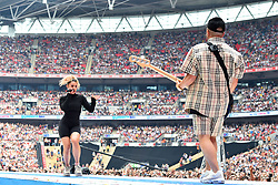 Raye and Jax Jones during Capital's Summertime Ball with Vodafone at Wembley Stadium, London. This summer's hottest artists performed live for 80,000 Capital listeners at Wembley Stadium at the UK's biggest summer party. Performers included Camila Cabello, Shawn Mendes, Rita Ora, Charlie Puth, Jess Glyne, Craig David, Anne-Marie, Rudimental, Sean Paul, Clean Bandit, James Arthur, Sigala, Years & Years, Jax Jones, Raye, Jonas Blue, Mabel, Stefflon Don, Yungen and G-Eazy
