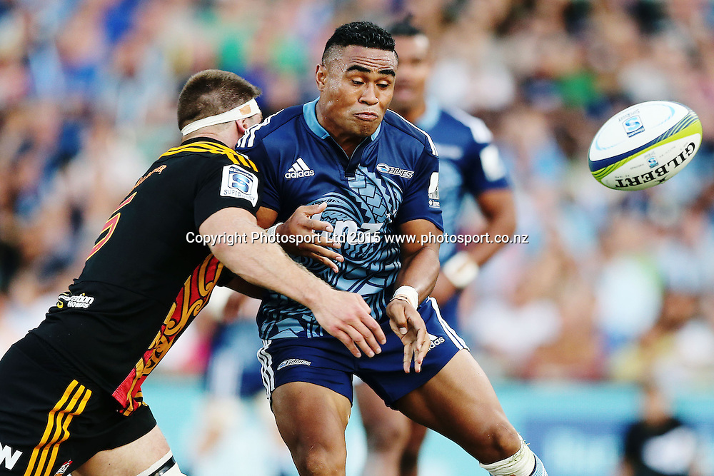 Francis Saili of the Bluesis tackled by Mike Fitzgerald of the Chiefs. Super Rugby match, Blues v Chiefs at QBE Stadium, Auckland, New Zealand. Saturday 14 February 2015. Photo: Anthony Au-Yeung / www.photosport.co.nz