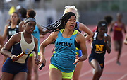 May 19, 2018; Torrance, CA, USA; Ariyonna Augustine runs the third leg on the Long Beach Poly girls 4 x 400m relay that placed fourth in the Division I race in 3:49.66 during the CIF Southern Section Finals  at El Camino College.