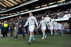 Oxford University captain Jacob Taylor and Harry Peck of Cambridge University lead their teams out onto the field - Photo mandatory by-line: Patrick Khachfe/JMP - Mobile: 07966 386802 11/12/2014 - SPORT - RUGBY UNION - London - Twickenham Stadium - Oxford University v Cambridge University - The Varsity Match