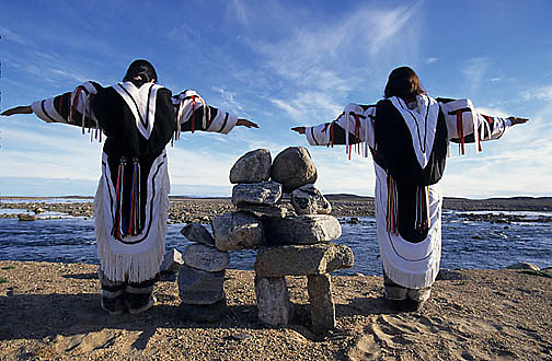 "Northwest Territories, known as Nunuvat, Canada. Inuit women in traditional ""Amautiq"" near Sila river, Wager Bay."