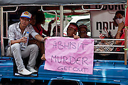 Apr. 12, 2010 - BANGKOK, THAILAND: Red Shirts call for the Thai Prime Minister to resign during a motorcade Monday. The funeral cortege for the Red Shirts killed in the violent crackdown Saturday wound through Bangkok Monday. Thousands of mourners came out to pay respects for dead Red Shirts. 21 people, including 16 Thai civilians were killed when soldiers tried to clear the Red Shirts' encampment in Bangkok. Thousands more came out to call for the government of Thai Prime Minister Abhisit Vejjajiva to step down. Today Gen. Anupong Paojinda, the Chief of Staff of the Thai Army, reiterated that the Army would not use violence to break up the protests and joined the call for the Prime Minister to call new elections. This is the beginning of Songkran, Thai New Year's week, and the government has cancelled the official festivities fearing more violence. It was during last year's Songkan festivities that the Thai Army and police used force to break up the Red Shirt protests. That protest is now called the Songkran Riots.     Photo By Jack Kurtz