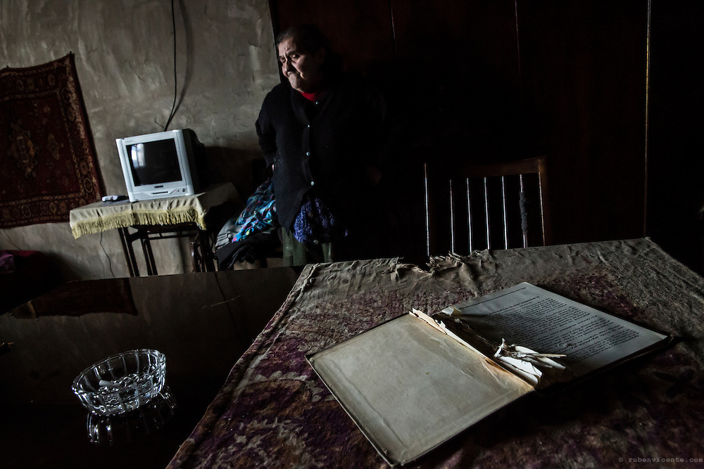 Hasmik has been burning pages from a Lenin book to feed the heater in her house. Gyumri, Armenia