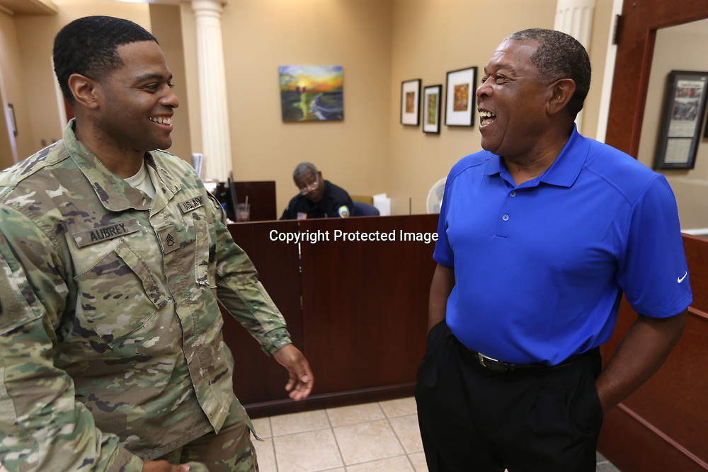 Army Staff Sergeant Rod Aubrey talks with Larry Holliday, Army Master Sergeant and West Point native, as they meet in city hall for the reading of a proclamation commemorating U.S. Army Day Wednesday morning in Tupelo.