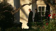 President George W. Bush walks from the Oval Office of the White House to Marine One on the first leg of his trip to Lima, Peru on November 21, 2008.  Secretary of State Condoleezza Rice is walking with President Bush.Photograph by Dennis Brack