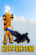 The kitschy Coppertone girl and her dog are a Miami landmark. <br /> <br /> Based on a sketch for a logo by the Tally Embry advertising agency in 1953, the 33- foot-high sign -- the girl alone is 27 feet tall --was originally installed on a downtown office building. <br /> <br /> But in 2009 she was relocated to Miami's rapidly redeveloping MiMo Biscayne Boulevard Historic District where she lives on as a somewhat hokey, slightly controversial, and undeniably nostalgic, Mid-Century Modern, pop-art icon.