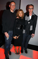 Left to right, designer GILES DEACON, actress EVA MENDES and STUART VEVERS Design Director at Mulberry at a party to celebrate the launch of a range of leather accessories designed by Giles Deacon for Mulberry held at Harvey Nichols, Knightsbridge, London on 30th October 2007.<br />