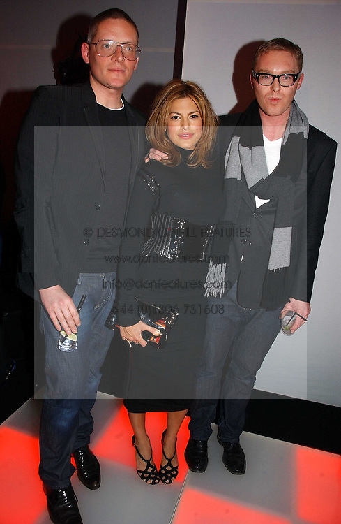 Left to right, designer GILES DEACON, actress EVA MENDES and STUART VEVERS Design Director at Mulberry at a party to celebrate the launch of a range of leather accessories designed by Giles Deacon for Mulberry held at Harvey Nichols, Knightsbridge, London on 30th October 2007.<br /><br />NON EXCLUSIVE - WORLD RIGHTS