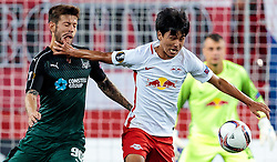 15.09.2016, Red Bull Arena, Salzburg, AUT, UEFA EL, FC Red Bull Salzburg vs FC Krasnodar, Gruppe I, 1. Runde, im Bild Fedor Smolov (FC Krasnodar), Takumi Minamino (FC Red Bull Salzburg) // during the UEFA Europa League, group I, 1st round match betweenFC Red Bull Salzburg and FC Krasnodar at the Red Bull Arena in Salzburg, Austria on 2016/09/15. EXPA Pictures © 2016, PhotoCredit: EXPA/ JFK
