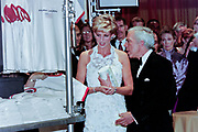 Diana, Princess of Wales views a display with fashion designer Ralph Lauren, right, during a charity gala fundraising event for the Nina Hyde Center for Breast Cancer Research September 24, 1996 in Washington, DC.