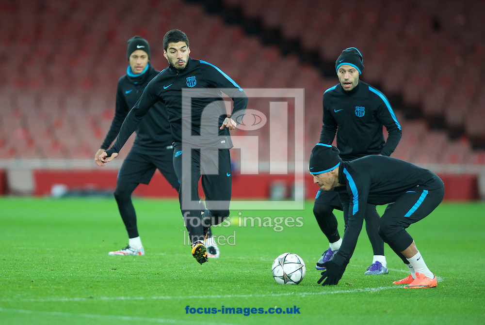 Luis Suarez chases down the ball during the Barcelona training session at the Emirates Stadium, prior to their Champions League match against Arsenal tomorrow. London, England.<br /> Picture by Alan Stanford/Focus Images Ltd +44 7915 056117<br /> 22/02/2016
