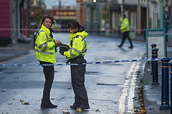 © London News Pictures. Aberystwyth,UK. 17/11/2016.<br /> Police stand at a safety cordon. A tornado , with winds of over 80mph, reportedly tore through the town of Aberystwyth on the morning of Nov 17, bringing extensive damage in its wake.  Slates were blown off roofs, windows sucked out, and chimney stacks destroyed, Large  parts of the town have been closed to traffic and pedestrians because of the risk of further damage. Photo credit: Keith Morris/ LNP