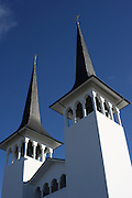Looking up at the spires of the Háteigskirkja church in Reykjavik, Iceland.