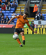 Scott Golbourne send the ball down field during the Sky Bet Championship match between Bolton Wanderers and Wolverhampton Wanderers at the Macron Stadium, Bolton, England on 12 September 2015. Photo by Mark Pollitt.