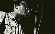 Paul Heaton singing into microphone, wearing hat, jacketed glasses, Manchester, UK, circa 1989,