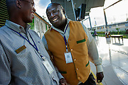 Train driver Dan Aluoch and Station Master Mike Mulwa chat whilst waiting at the new Syokimau Railway Station for the new Nairobi Commuter Railway train to depart at 18.35 for Nairobi city centre. The new railway system costing KSh.400 million was launched by Kenya's President Mwai Kibaki on Tuesday 13th November 2012 marking the next stage of railway development in the country since the earliest accounts of Nairobi's history dating back to 1899. Costing Sh120 one way passengers cover the 18-kilometre journey in a comfortable 30 minutes.