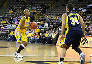 26 JANUARY 2009: Iowa guard Kachine Alexander (21) looks to the basket while Michigan guard Jessica Minnfield (34) closes in during the first half of an NCAA women's college basketball game Monday, Jan. 26, 2009, at Carver-Hawkeye Arena in Iowa City, Iowa. Iowa defeated Michigan 77-69.