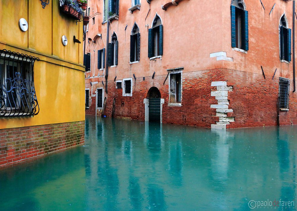 "The junction between Rio di San Provolo and Rio San Severo, two canals in Venice, Italy. Taken on a rainy morning of January, with an exceptional high level of the water due to the ""acqua alta"" (high tide), the phenomenon that occasionally flood the city of Venice in winter."