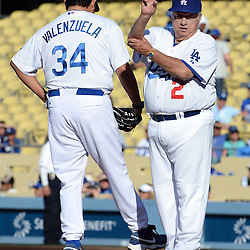 Former Los Angeles Dodgers manager Tommy Lasorda (2) goes to the bullpen as he takes Fernando Valenzuela out of the game during the Old-Timers game after the Los Angeles Dodgers defeated the San Francisco Giants 6-2 during a Major league baseball game on Saturday, May 10, 2014 in Los Angeles. <br />  (Keith Birmingham/Pasadena Star-News)