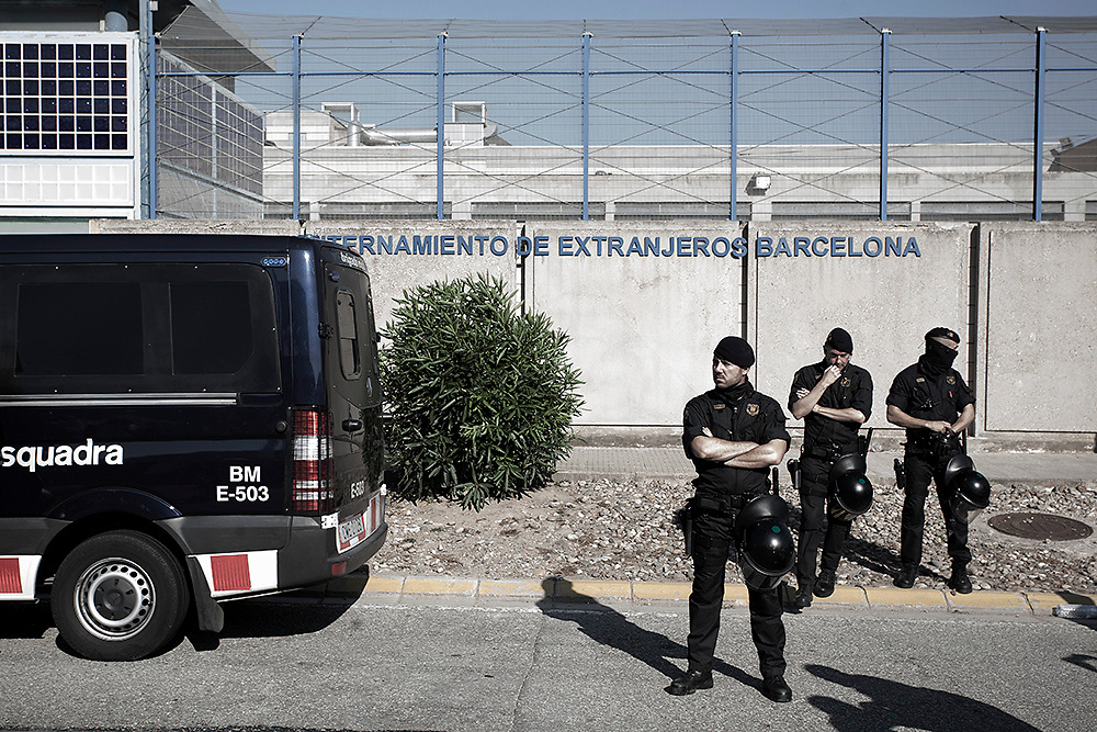 "The Mossos d'Esquadra - the police force of Catalonia, stand by the entrance of the CIE durning the protests organized by ""Tancarem el CIE"" - Barcelona  20/06/2015"