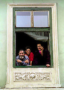 LOCAL PEOPLE AT WINDOW IN THE MEDIEVAL TOWN OF SIBIU IN ROMANIA
