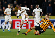 Kemar Roofe of Leeds United rides a tackle from Markus Henriksen of Hull City during the EFL Sky Bet Championship match between Hull City and Leeds United at the KCOM Stadium, Kingston upon Hull, England on 30 January 2018. Photo by Paul Thompson.