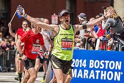 2014 Boston Marathon: elated runner heading for the finish line