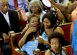 Attendees come to remember the nine lives lost on Wednesday evening during services at Emanuel AME Church on Sunday morning after the church reopened for the first service they were slain Wednesday night during a Bible study. Photo taken Sunday, June 21, 2015 at Emanuel AME Church. Paul Zoeller/Staff