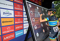 Brodie CHAPMAN (AUS) Team Tibco &ndash; Silicon Valley Bank signs the Signature Board ahead of The Prudential RideLondon Classique. Saturday 28th July 2018<br /> <br /> Photo: Bob Martin for Prudential RideLondon<br /> <br /> Prudential RideLondon is the world's greatest festival of cycling, involving 100,000+ cyclists - from Olympic champions to a free family fun ride - riding in events over closed roads in London and Surrey over the weekend of 28th and 29th July 2018<br /> <br /> See www.PrudentialRideLondon.co.uk for more.<br /> <br /> For further information: media@londonmarathonevents.co.uk