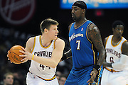 April 13, 2011; Cleveland, OH, USA; Cleveland Cavaliers forward Luke Harangody (44) looks for a pass around Washington Wizards power forward Andray Blatche (7) during the first quarter at Quicken Loans Arena. Mandatory Credit: Jason Miller-US PRESSWIRE