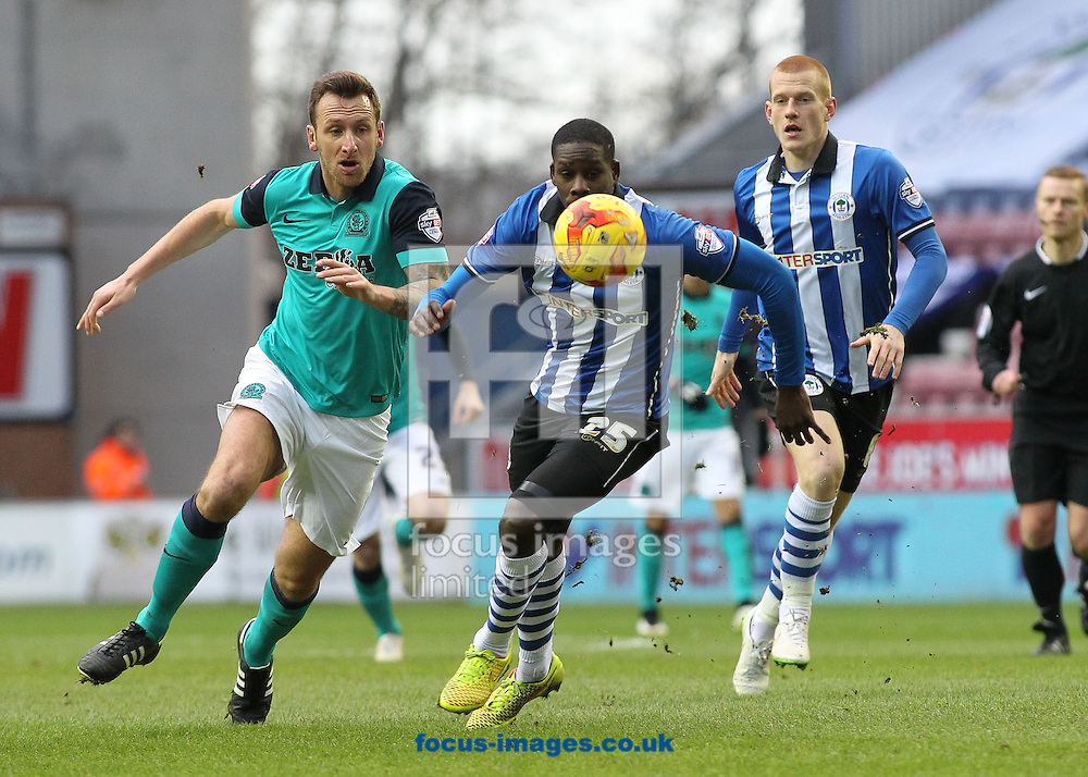 Leon Barnett of Wigan Athletic and Chris Brown of Blackburn Rovers in action during the Sky Bet Championship match at the DW Stadium, Wigan.<br /> Picture by Michael Sedgwick/Focus Images Ltd +44 7900 363072<br /> 17/01/2015
