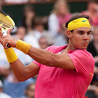 31 May 2009: Rafael Nadal of Spain eyes the ball as he prepares a backhand during the men's Singles fourth round match on day eight of the French Open at Roland Garros in Paris, France.
