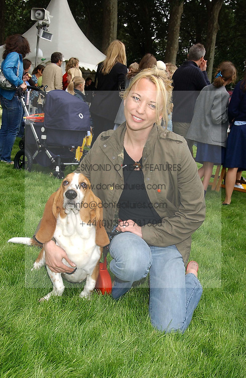 Radio presenter SARA COX and her dog Snoop  at the 3rd annual Macmillan Dog Day in aid of Macmillan Cancer Relief held at Royal Hospital Chelsea, London SW3 on 5th July 2005.<br /><br />NON EXCLUSIVE - WORLD RIGHTS