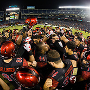 24 November 2018: San Diego State Aztecs linebacker Kyahva Tezino (44) pumps the team up during the pre-game warm-up. The Aztecs closed out the season with a 31-30 overtime loss to Hawaii at SDCCU Stadium.
